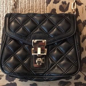New and never worn quilted cross body bag